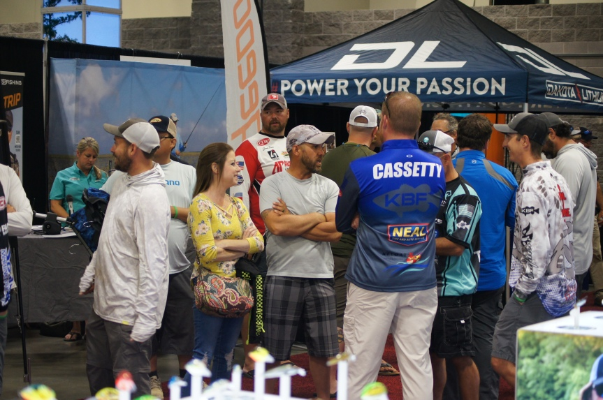 Darrell Cornelius and his wife Tanya talking with some of the anglers